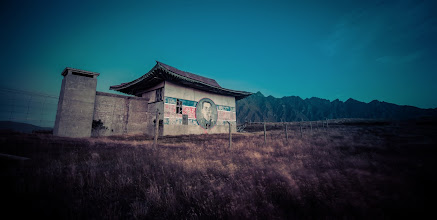 """Photo: Abandoned North Korean Prison in... New Zealand???  I've always wanted to get up to this place, but it has been virtually impossible since they closed all the roads years ago.  And yes, it's right here in Queenstown, New Zealand, atop Deer Park Heights, a huge mountain that can be seen from pretty much everywhere in the valley. It might not look like a mountain next to the Remarkables, but it is huge. Everything in New Zealand is so epic that you lose track of the scale of things. For example, did you know that they make Cinderella's castle in Disneyworld look bigger by using a forced perspective trick by making the upper spires much smaller than they would normally be? This is what happens with the relatively """"small"""" mountains around here. So you'll see Deer Park Heights and think, """"Oh, I could climb that thing myself!"""" Well, maybe you could, but you won't make it down by nightfall.  So, WHY, I hear you wondering, is there an abandoned North Korean prison in Queenstown? It was actually built as a movie set for a movie in the 80′s by Disney. It was called """"The Rescue"""" — and it was horrible. The plot involved a bunch of young boys who had to rescue their dads who had gotten themselves imprisoned in North Korea. I think it skipped the theaters and went straight to airplanes, along with Miss Congeniality 4.  How was I able to get up here and take about 20 new friends? I cannot say!"""