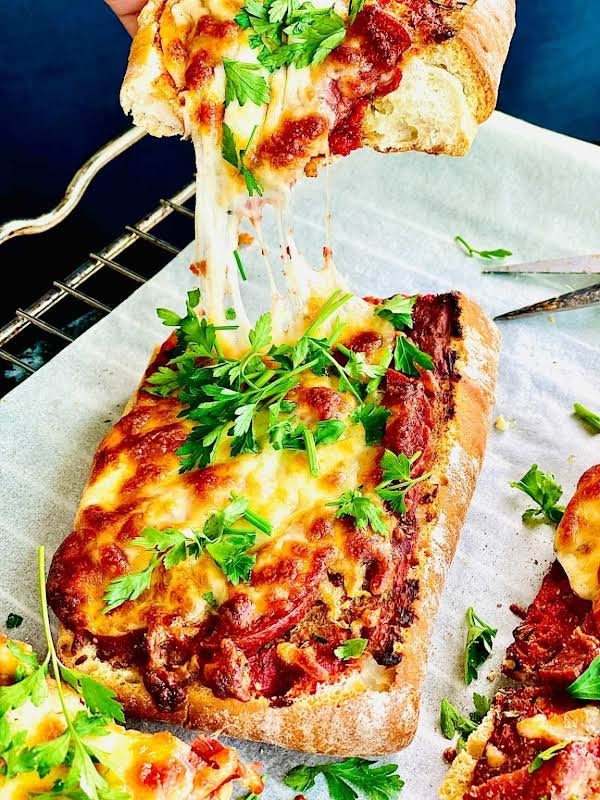 A Quick Vegetarian Pizza Using Only A Few Ingredients Like Tomato Sauce, Cheese Herbs, Olives And Ciabatta Bread. Ready In No Time And So Tasty Too.