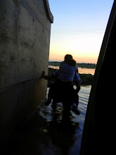 Photo: After about an hour of digging, pushing, and pulling, Namka's brother carried the two of us to dry land.