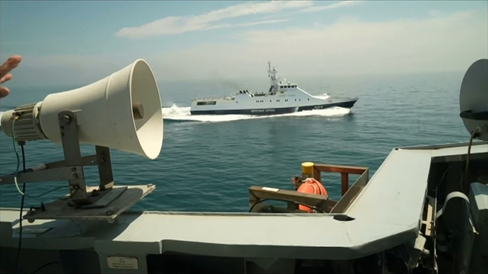 Two Black Sea Fleet coastguard ships continued to shadow HMS Defender from 100 yards away