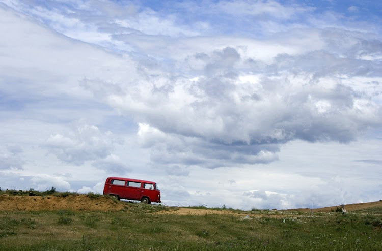 An old Kombi takes a rest on an alternative road somewhere in the Klein Karoo, where ostrich farms lie hidden between the curve of green hills and mystery. Picture: WEEKEND POST
