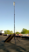 Photo: Temporary 10foot tripod for Nanostation M5 made from aluminum light stand.  The roof hatch is resting on the stand's legs since it was gusty.