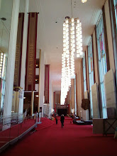 Photo: The foyer leading to the Concert Hall. The main color palette in the KC is red and gold.