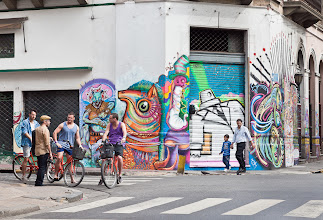 """Photo: """"Spray Can Suit and Hipsters on Bikes - Buenos Aires, Argentina""""  The streets of Buenos Aires, Argentina are covered with interesting and colorful street art of every style imaginable - some of it done with permission, much of it not.  Some view street art as vandalism, I personally love it and enjoy photographing it. That said, I might not feel the same if someone painted the side of my house, unless it was a really awesome piece :)  Continuing #StreetArtSunday with this post - +Lotus Carroll are we going to start using this hashtag from now on?  #streetart #graffiti #Argentina #BuenosAires #mural"""
