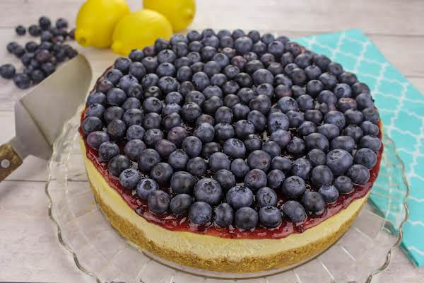 Blueberry Cheesecake With Blueberries On Top.