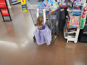 Photo: Even the little princess is dragging at this point in the trip. We opted for the Little People palace. I bought every single one they had (3) but honestly, it wasn't what I wanted to be donating to Angel Tree.