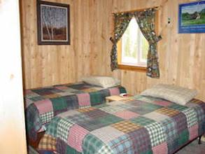 Photo: Cabin 4 downstairs bedroom view.  full bathroom on same floor next to bedroom.