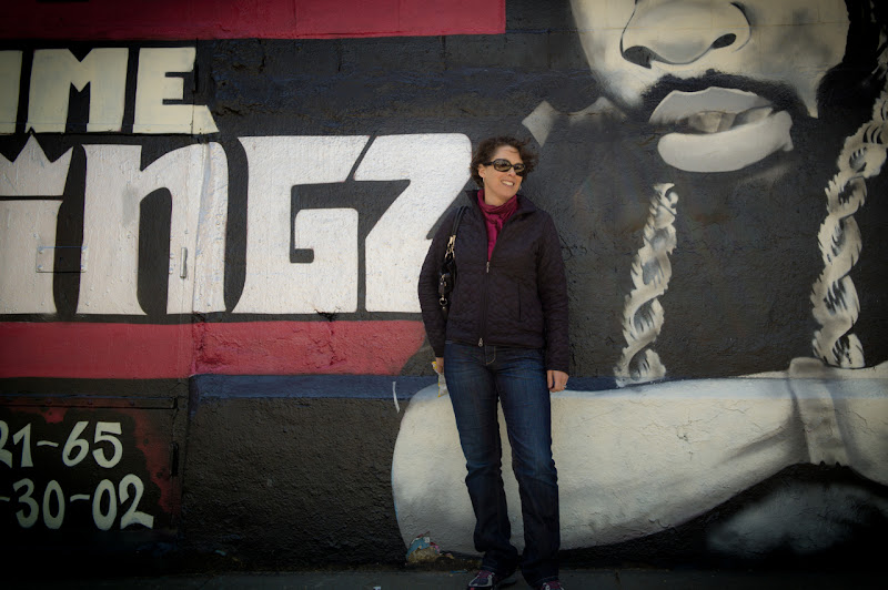 Photo: Tammy posing in front of one of the murals