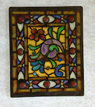 Photo: Shell/Floral - Diane Echnoz Almeyda - Miniature Stained Glass Window using Plique-a-Jour Enamel Technique - Approximately 47mm x 56mm - Oxidized Sterling Silver, Plique-a-Jour Enamels - $600.00 US - (One of a Pair - Sold Individually)