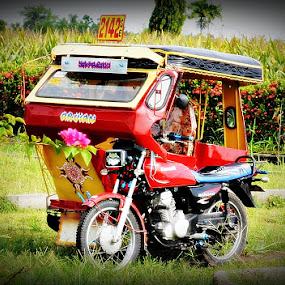 by Mark Tomboc - Transportation Motorcycles