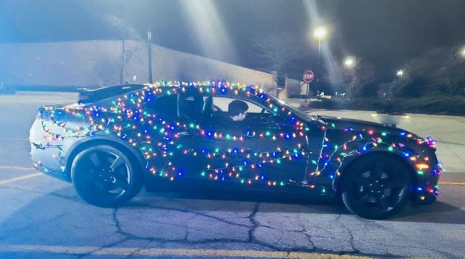 Tyler Kamholz, 18, was pulled over and given a warning by a Wisconsin State Patrol trooper who spotted him driving around with his car covered in Christmas lights. Photo courtesy of the Wisconsin State Patrol