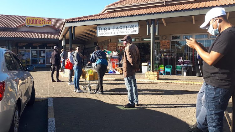 "A queue of about 20 people outside Liquor City at the Sophiatown Shopping Complex. Two individuals who preferred not to be named said that they specifically woke up early to come and queue. ""We are planning on getting cases of beer, we just hope that they won't limit quantities too much because we don't want to have to come here again tomorrow."