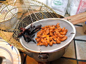 Photo: fried cashews and dried chillies drained from oil