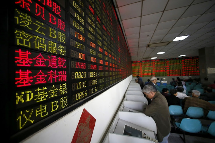 Investors look at computer screens showing stock information in Shanghai, China.  Picture: REUTERS/ALY SONG