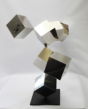 Photo: 42 REFLECTIONS - 33H X 40W X 25D Polished Stainless Steel, Painted Mild Steel,  Side 1 View