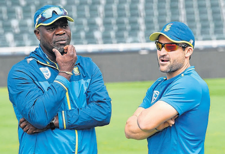 Big responsibility: SA coach Ottis Gibson and stand-in skipper Dean Elgar in discussion on Thursday on the eve of the third Test against Pakistan at the Wanderers. Picture: GALLO IMAGES/LEE WARREN