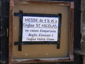 Photo: This sign on the Church notes that because of all the bird damage here, Sunday Mass is at the St Nicolas Church.