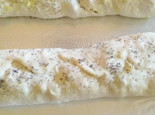 Spread with 1 tablespoon of mayonnaise and sprinkle with poppyseeds if desired.