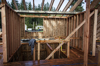 """Photo: This dormer needed to be cut """"up"""" for headroom at the stairs.  To get tall enough windows, the topplate is a 6x6"""