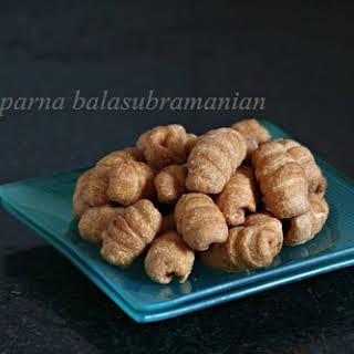 Kulkuls/ Kalkals/ Kidyo (Sugar Glazed Deep-Fried Dough Curls).
