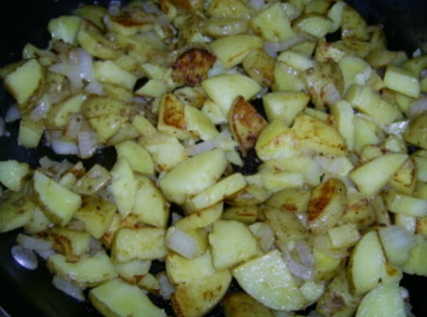 Spray a non-stick skillet with the olive oil spray. Add potatoes and onions. Brown...