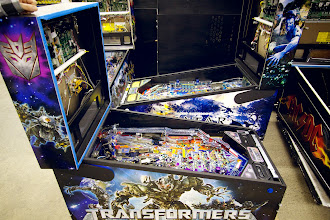 Photo: Transformers and Avatar pinballs. Transformers uses a new printing technique with stickers (higher quality, more saturated colours) instead of painting on the cabinet