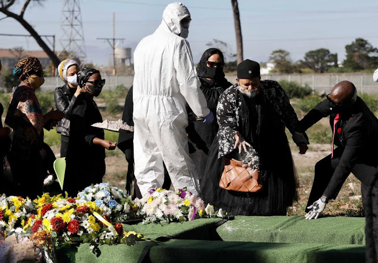 Cameraman Lungile Tom's wife Nandipha Nombutuma bids farewell at Maitland cemetery in Cape Town last week. The projected number of deaths in the Western Cape has been increased from below 5,500 to 9,300 by the end of November.