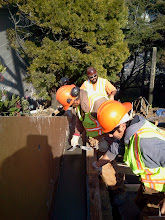 Photo: San Francisco Department of Public Works employees smoothing newly-poured concrete for retaining wall as repair work continues on Hidden Garden Steps site (16th Avenue, between Kirkham and Lawton streets in San Francisco's Inner Sunset District) in February 2013; for more information about the Hidden Garden Steps project, please visit http://hiddengardensteps.org.