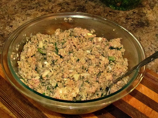 In a large bowl, mix together the meat, quinoa, garlic, paprika, parsley and season...