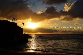 "Photo: PEOPLE CATEGORY, FINALIST. Sunset leap at ""The Rock,"" Waimea Bay, Oahu. Photo by Anthony Nguyen, Mililani, Oahu."