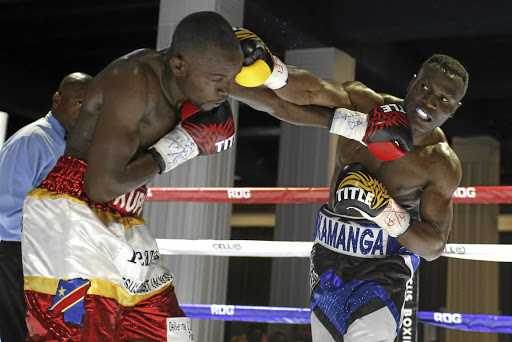 Raymond Kupula against Clement Kamanga in their bout at Turffontein Racecourse,Johannesburg, on Sunday.