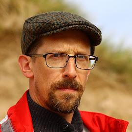 Puzzled by Chrissie Barrow - People Portraits of Men ( glasses, cap, expression, man, portrait )