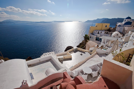 Sunlight reflects in the Aegean on a late November afternoon as seen from the cliffs of Oia on Santorini, Greece.