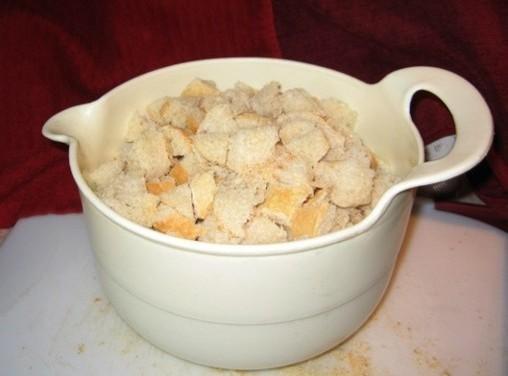 Break the bread into small pieces, add corn meal, sugar, eggs and milk and...