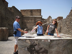 Photo: Pompeiin restaurant. There would have been hot food in the counter containers, and the customers ate standing up