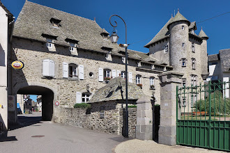 Photo: The Chateau (now a retirement home) at Montsalvy, an interesting old town in the Cantal, about an hour and a half east of us. (All retirement homes should have a bar across the street!)
