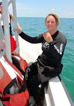 Photo: Thadra Stanton after a very successful dive!  (it is tonic water)