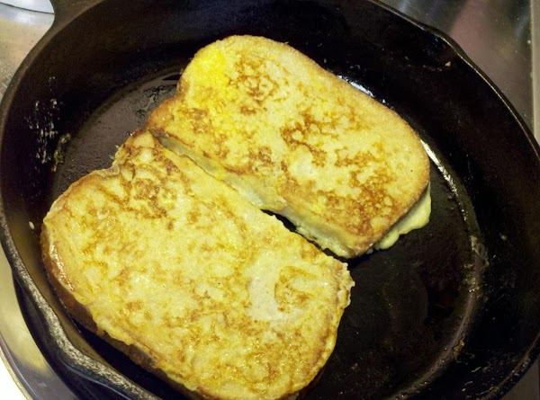 Cook the bread slices a few minutes on each side in the buttered skillet,...