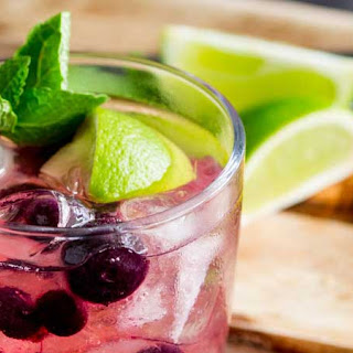 Gin and Tonic Muddled with Blueberry, Lime and Mint.