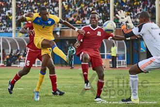 Photo: Moments after having a goal disallowed, Jean-Baptiste MUGIRANEZA strikes again from close range [Rwanda v Mauritius, AFCON 2017 Qualifier, 29 March 2016 in Kigali, Rwanda.  Photo © Darren McKinstry 2016, www.XtraTimeSports.net]