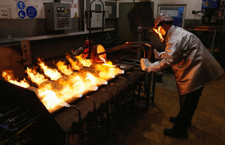 An employee casts ingots of 99.99% pure gold at the Krastsvetmet non-ferrous metals plant in the Siberian city of Krasnoyarsk, Russia. Picture: REUTERS/ILYA NAYMUSHIN/FILE PHOTO