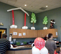 Photo: Humane Society of West Michigan's Home for the Holidays & Argus Program event with Author Jim Gorant (The Lost Dogs) The goal chart, balloon dog started at the end and moved to the house as the adoptions went through.