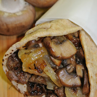 Greek Steak Pitas with Caramelized Onions and Mushrooms.