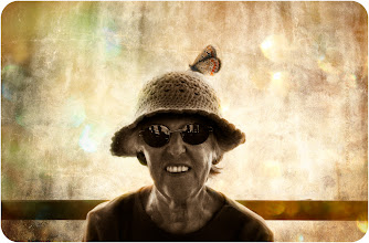 Photo: I met this old woman and I can forget her, because she was light and wise like a ray of sun in a cloudy day  and she liked so much her hat .. so this is her portrait for me ..like a butterfly sorrounded by the light