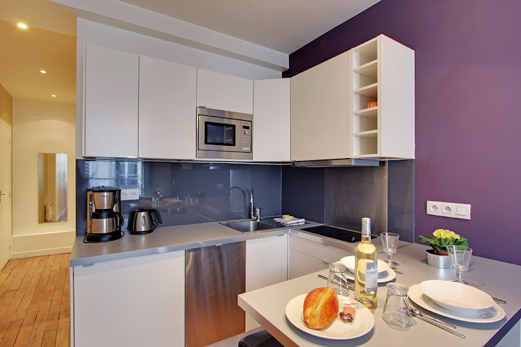 Full kitchen at Studio Apartment on Rue Du Temple
