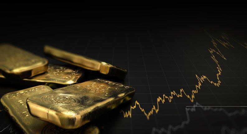 Des lingots d'or adossés au cours grimpant