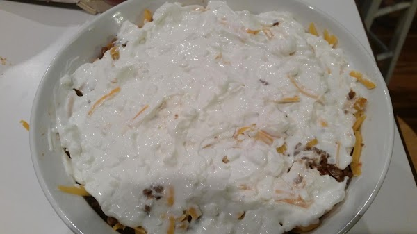 In a 2 - 3 quart casserole dish,  layer 2 cups of the...