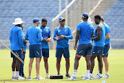 Vincent Barnes (C) bowling coach of South Africa speaks to bowlers during the South African national men's cricket team training session and press conference at Maharashtra Cricket Association Stadium on October 08, 2019 in Pune, India.