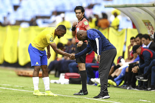 Sibusiso Vilakazi celebrates his goal with coach Pitso Mosimane during the CAF Champions League match against USM Alger at Loftus on Saturday. Downs won 2-1. / Lefty Shivambu/Gallo Images