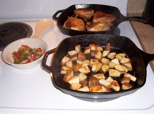 Wash chicken and pat dry.  Heat oil in heavy cast iron pan, ...